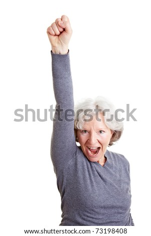 Cheering old senior woman clenching her fist
