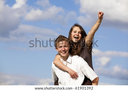 cheering teenage couple