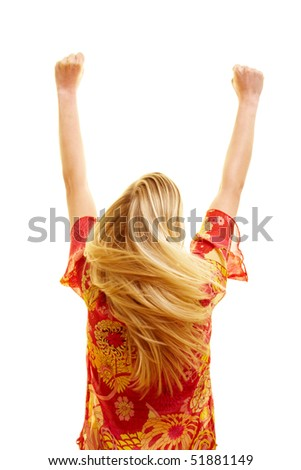Cheering woman from behind with flying hair and clenched fists