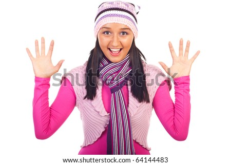 Cheering young tanned woman in pink-mauve winter clothes showing ten fingers isolated on white background