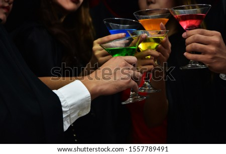Cheers! Group of people cheering with champagne  #1557789491