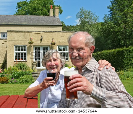 Cheers to over fifty years of married life. Couple in their 80s raise their glasses