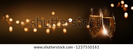 Cheers with tingling champagne to celebrate for a happy new year #1237550161