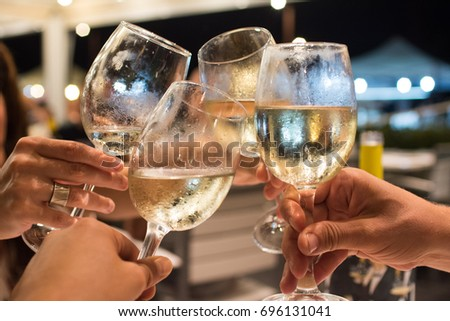 cheers with wine #696131041