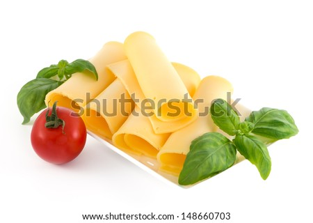 Cheese and basil leaves still life isolated on white background