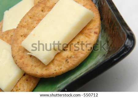 cheese and crackers on green plate