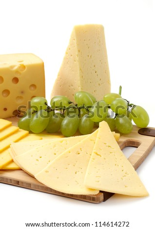 cheese and grapes on a white background