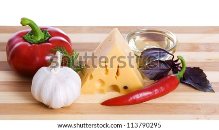 cheese and paprika on wooden board