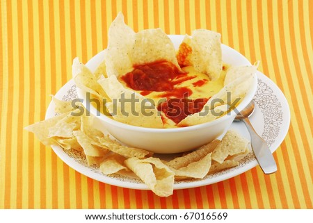 Cheese and Potato Soup with Tortillas and Salsa added to create the Hispanic or Mexican accent.  Chili con Queso dip with tortilla chips.