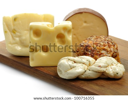 Cheese Assortment On A Wooden Board