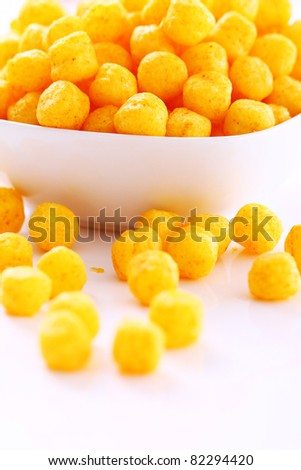 Cheese balls in the bowl isolated over white background - stock photo