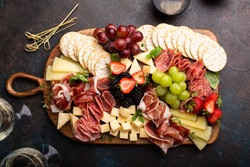 Cheese board for a holiday entertainment on dark background
