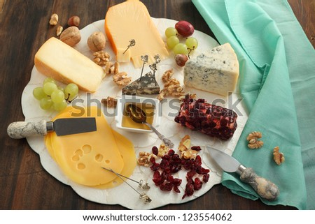 Cheese board with nuts, grape and dried cranberry