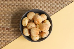 Cheese breads and cassava flour. Traditional from northern Argentina. Yellow and gray background