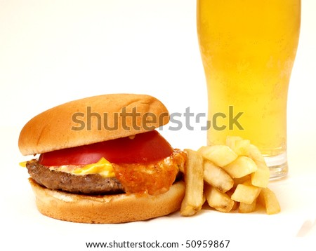 cheese burger and fries with beer aside