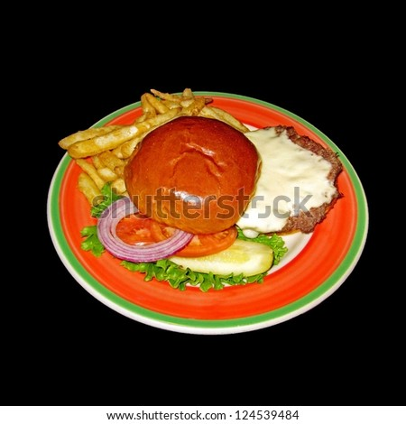Cheese burger on colorful orange and green plate with french fries