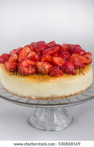 cheese cake / cheese cake topped with glazed strawberries.