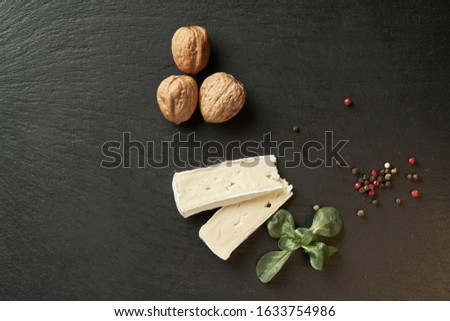 Cheese camembert or brie with rosemary and pepper on dark stone background. Copy space. Studio photo Сток-фото ©