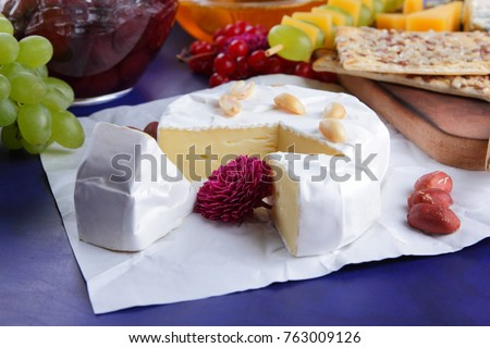 Cheese, camembert, wooden board, pear, Christmas cheese, honey, cherry jam, green grapes, dark blue background, pop art, red berries, Mexican cuisine, Indian cuisine #763009126