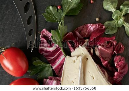 Cheese delikatessen closeup on black stone desk surface Сток-фото ©