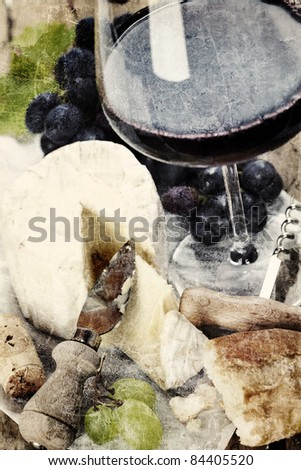 Cheese, grape and wine on wooden table