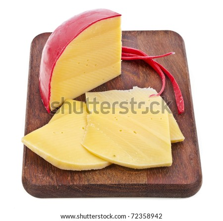 cheese in the wooden board isolated on white