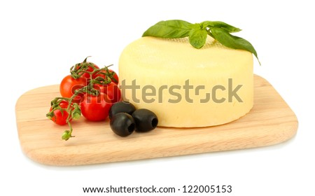 cheese mozzarella with vegetables on the cutting board isolated on white