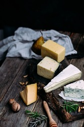Cheese on a wooden table. brie, dor blue, parmesan, gouda