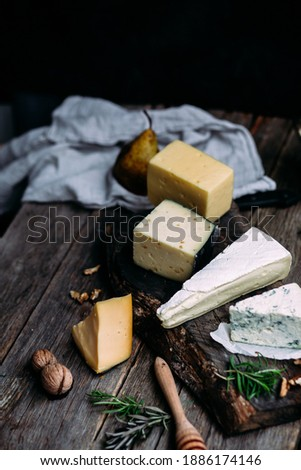 Cheese on a wooden table. brie, dor blue, parmesan, gouda Stockfoto ©