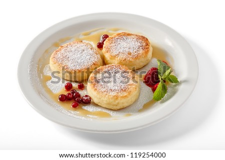 Cheese pancakes with red bilberry