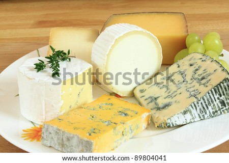 Cheese plate - various types of soft and hard cheese. International dairy delicacies.