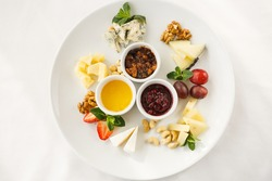 cheese plate with sauces in a restaurant