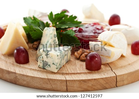 Cheese Platter with Grapes and Sweet Sauce
