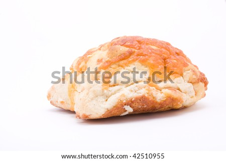 Cheese Scone from low viewpoint isolated against white background.