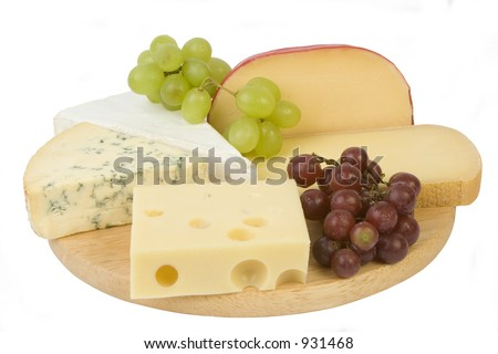 Cheese selection on woodboard - stock photo