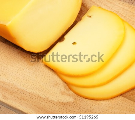 cheese slices on cutting board, top view
