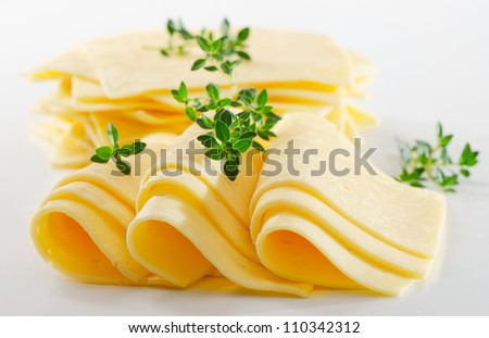 Cheese slices with fresh herbs