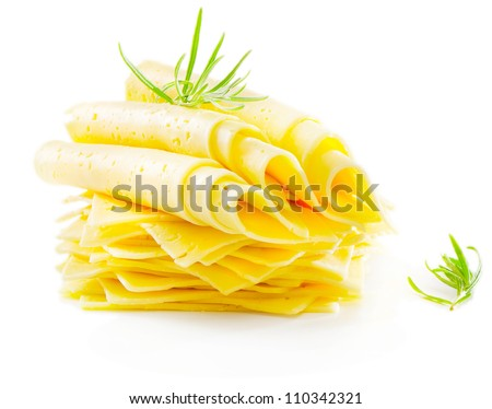 Cheese slices with fresh herbs isolated on white