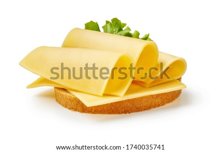 Cheese slices with salad leaf on piece of bread. Sandwich isolated on white background.