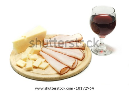 Cheese, smoked turkey sliced and a glass of wine in white background.