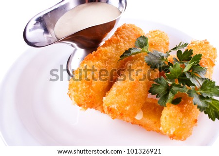 Cheese Sticks with milk, mayonnaise and parsley on the plate.