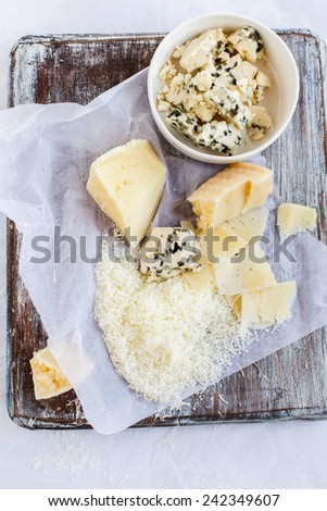 Cheese variety. Food background. Fresh ingredients on a wooden table