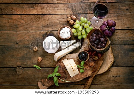 Cheese variety. Food background.  Fresh ingredients on wood