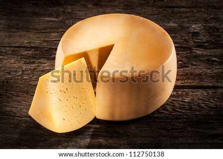 Cheese wheel on wood. Organic food
