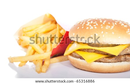 cheeseburger and a box of french fries isolated on white