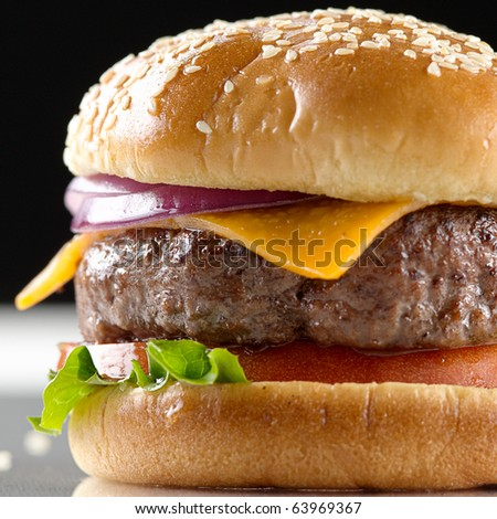 cheeseburger macro with black background and selective focus