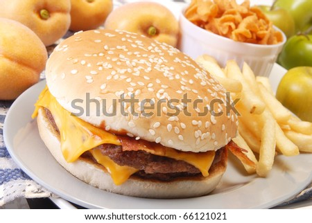 Cheeseburger with fries on the plate
