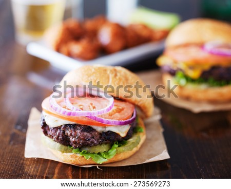 cheeseburgers with wings and beer