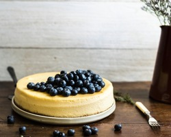 Cheesecake decorated with blueberries on a table
