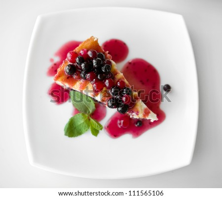 Cheesecake on a plate isolated